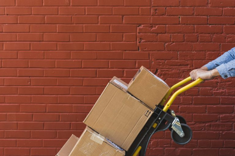 shipping-boxes-on-red-brick